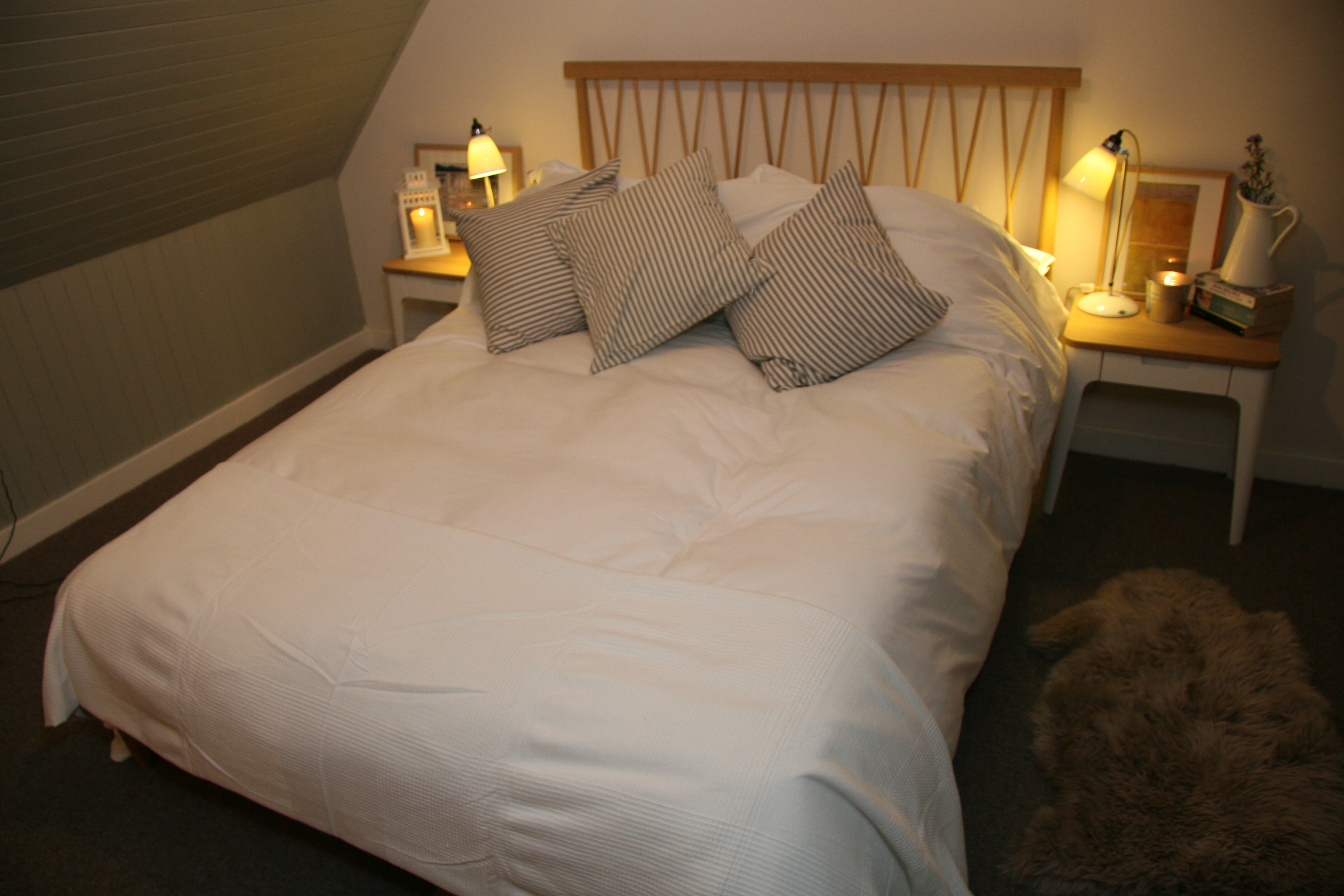 Stylish, comfortable bedroom with egyptian cotton sheets and beautifully crafted wooden furniture