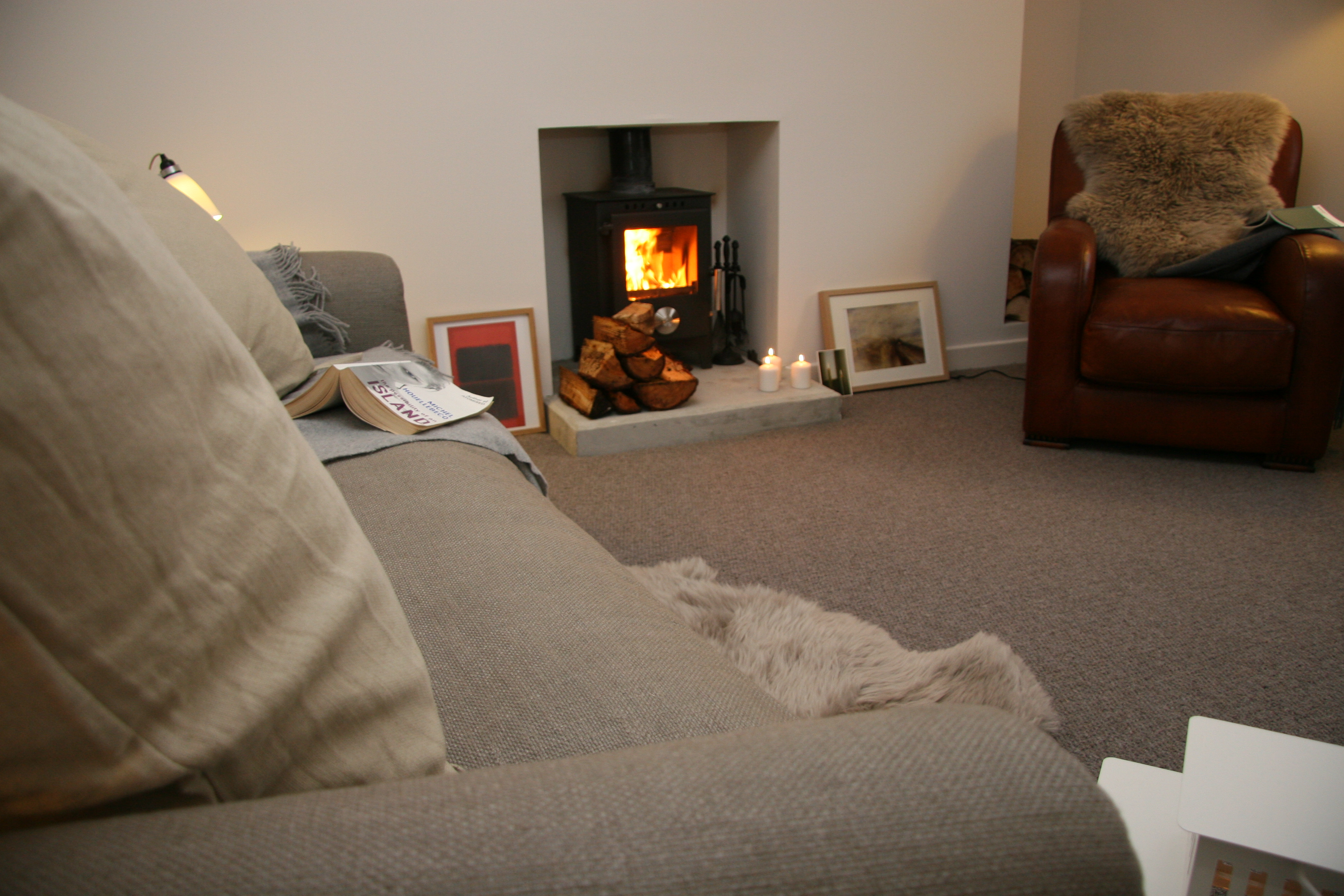 Skye White House Living Room - Beautiful linen sofa and wood burner - Luxury self-catering on the magical Isle of Skye, Scotland, United Kingdom