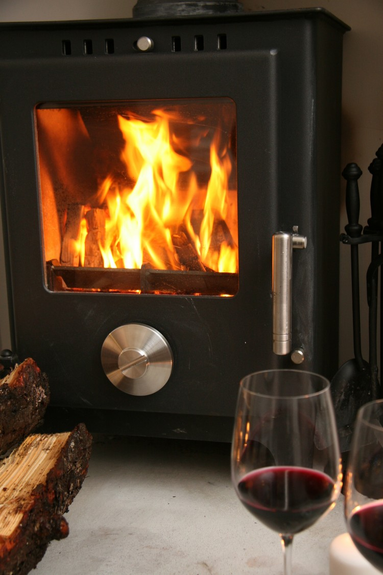 Skye White House - wood burning stove in the warm and cosy living room